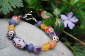 "Bracelet made from glass beads made by a ""fair-trade standard"" cottage industry in Indonesia."