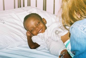 Sarah's first smile, at the hospital, 2004
