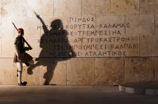"""An """"Evzone"""" soldier guards the Tomb of the Unknown Soldier and Greek Parliament in Syntagma Square, Athens. October 2015."""
