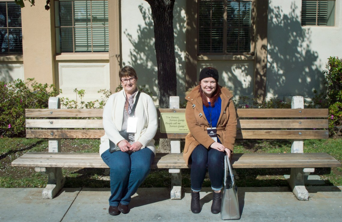My mom and I sitting on the bench from Forrest Gump on the Paramount Studio Tour in Hollywood, California.