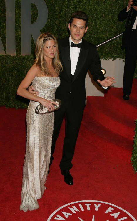 John Mayer with his arm around Jennifer Aniston on the red carpet at the 2009 Vanity Fair Oscar after party.