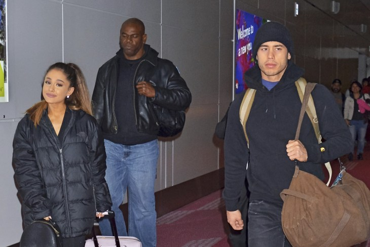 Ariana Grande and her boyfriend Ricky Alvarez at the Tokyo International Airport carrying luggage