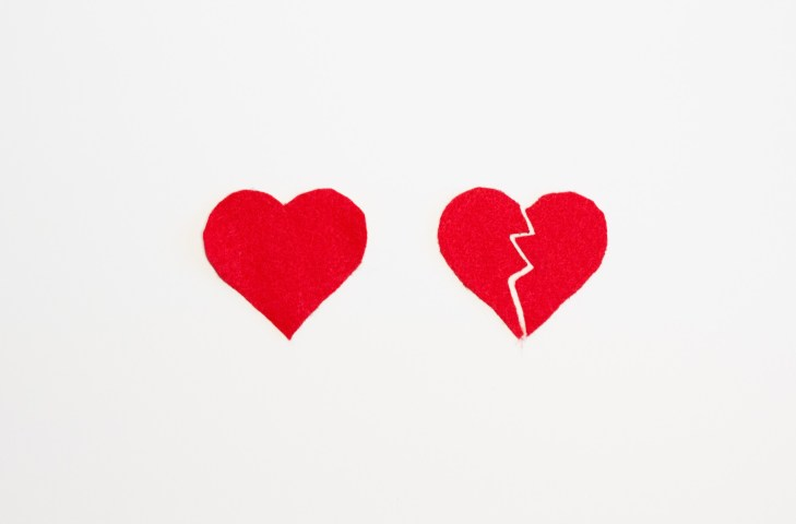 Two hearts one full and one broken in half