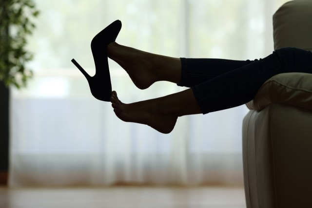 a woman taking off her heels