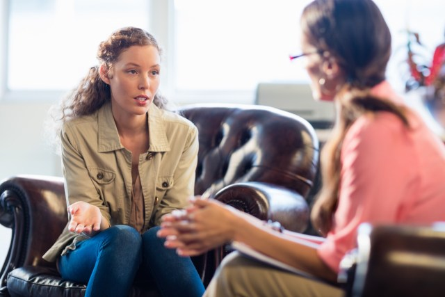 A patient in therapy talking to their counselor
