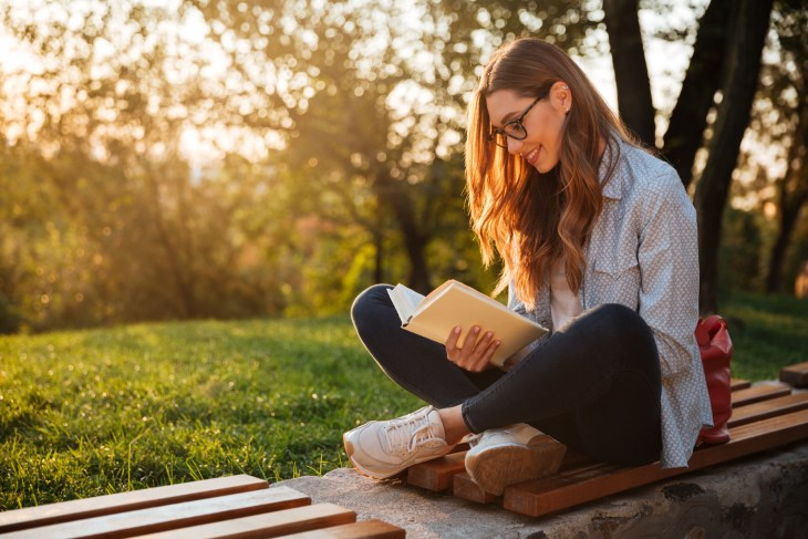 Woman reading in a park