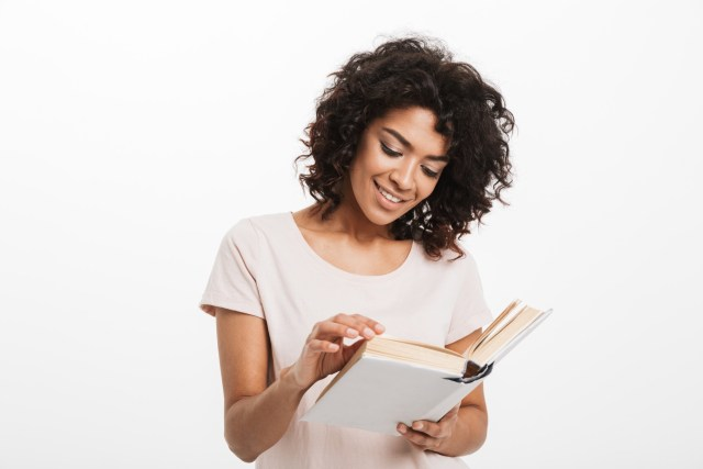 woman reading a book isolated over white background