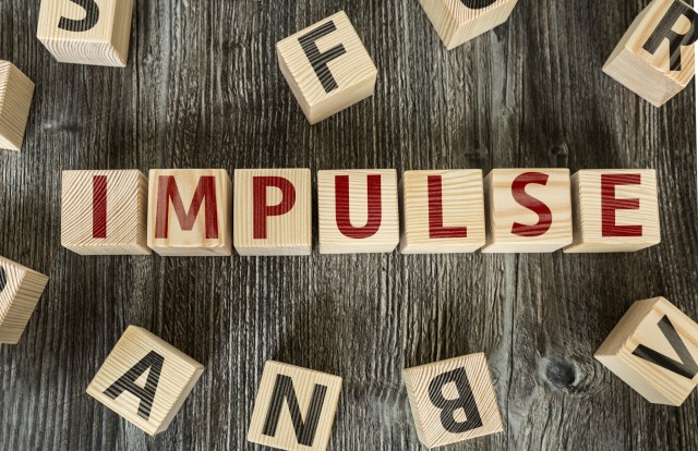 """Blocks spell out in red letters """"impulse"""""""