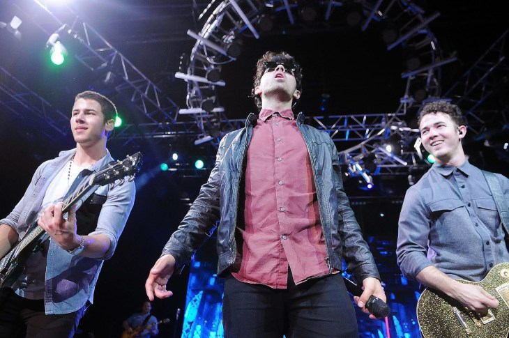 Worms eye view of Jonas Brothers (Nick, Joe and Kevin) performing in Rio de Janiero in 2013
