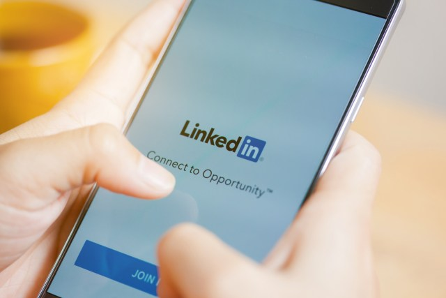 LinkedIn application on the screen. LinkedIn is a business-oriented social networking service.