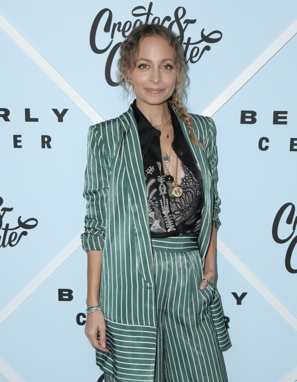Nicole Richie in loose-fitting, wide leg pants.