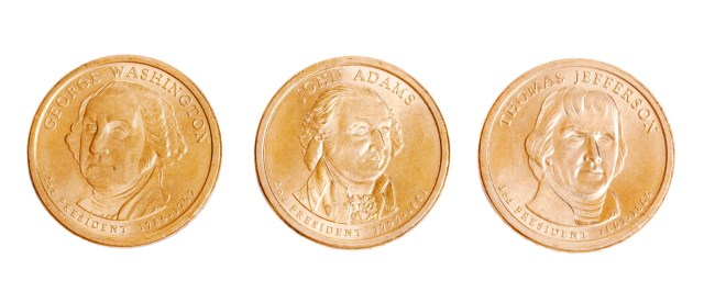 George Washington, John Adams and Thomas Jefferson on gold coins displayed on a white background.