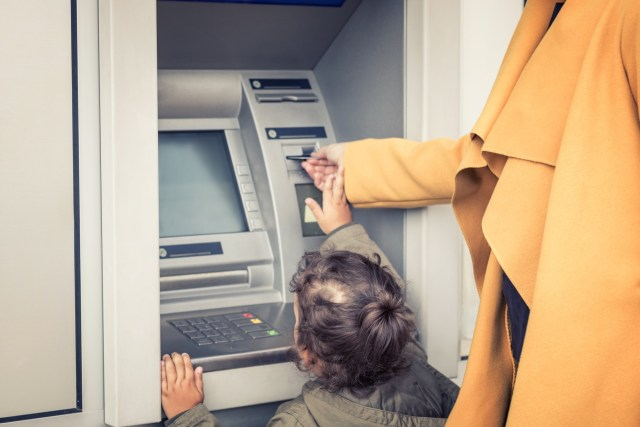 kid at an atm