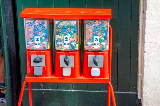 Traditional gumball machine is waiting for customers