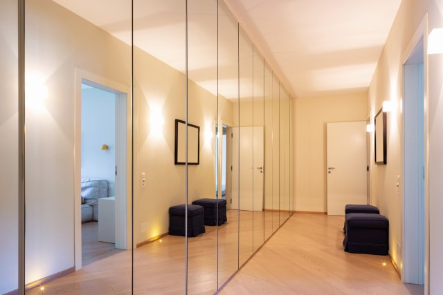 Corridor with wardrobes and mirrors