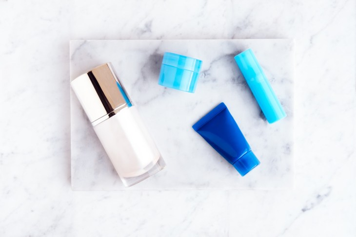 Beauty cosmetic products on white marble table