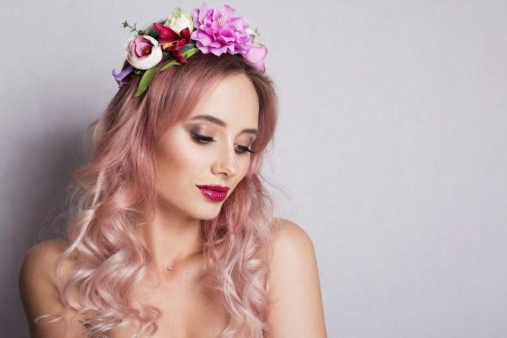 Pretty young woman pastel pink hair with Wreath of Pink Flowers