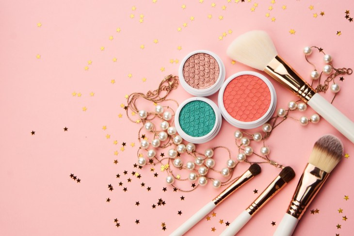 makeup brushes, eye shadow, fashion background
