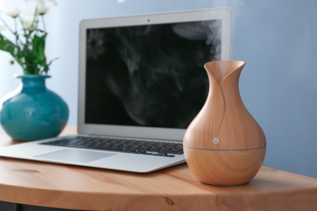 Aroma oil diffuser on table in room
