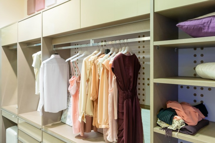 Outfits, Modern wooden wardrobe with women clothes