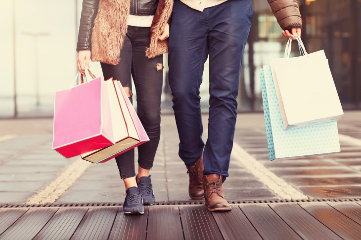 Couple Walking With Many Shopping Bags