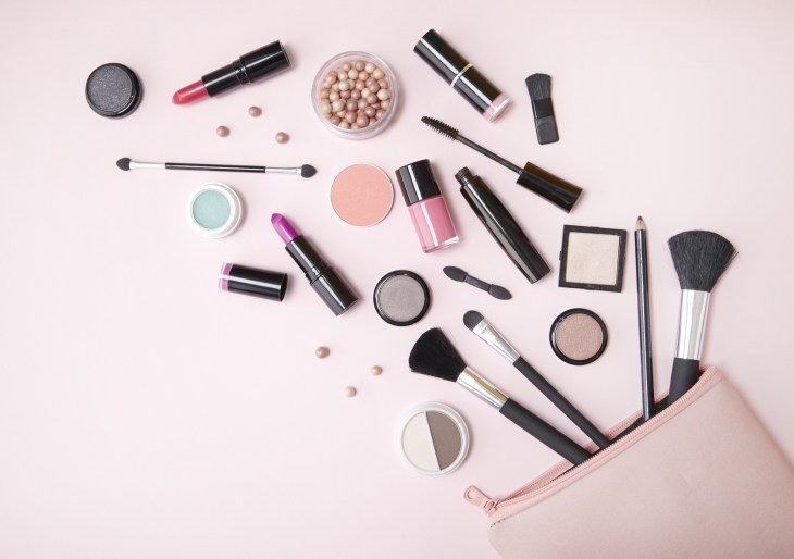 Array Of Makeup Products From Bag With Pink Background