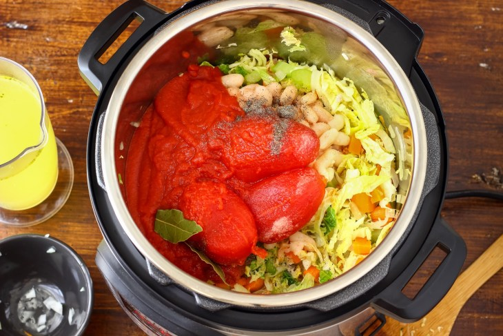 A slow cooker with ingredients inside.