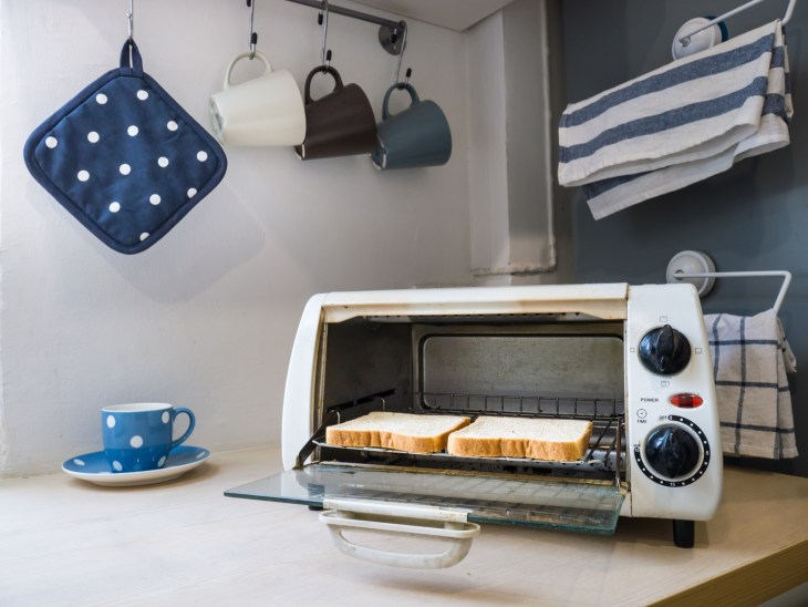 A toaster oven in a kitchen.