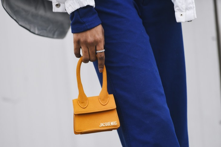 Someone holding tiny Jacquemus purse.