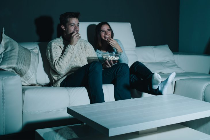 A woman and man watching a movie.