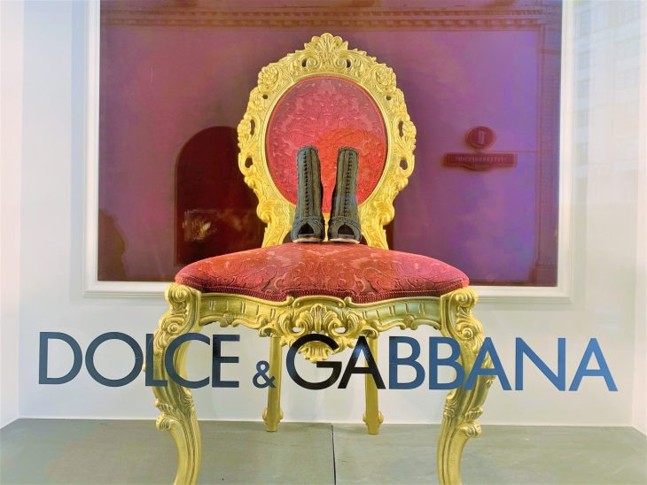 Window display and sign at Dolce & Gabbana store. It is a luxury Italian fashion house founded in 1985 in Legnano by Italian designers Domenico Dolce and Stefano Gabbana