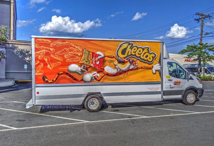 Cheetos delivery truck parked in a parking lot.