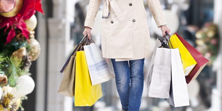 A person holding shopping bags.