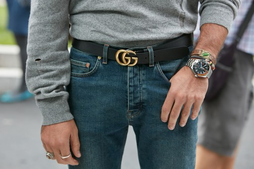 Man standing just showing his waist. He has a Gucci black bely and a nice watch