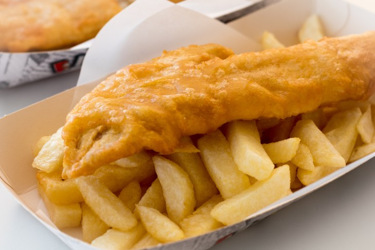 Fish and chips in a paper bowl