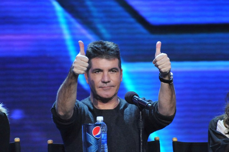 """Simon Cowell giving a thumbs-up at """"X-Factor"""""""