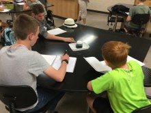 Mini forensic scientists observing a sample in Forensic Science.