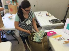 A student is crafting her own material in Decorative Papers.