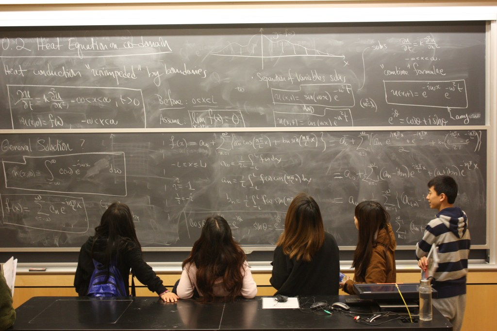 Students visiting a college lecture hall