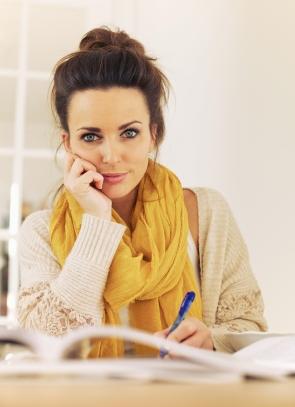 high school girl organizes her essays for college
