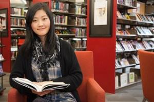 Girl studies at library