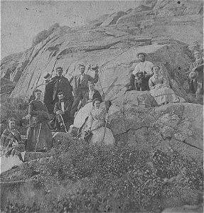 Picnickers near the top of Mount Monadnock, many years after the burning.