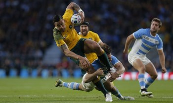 Israel Folau tackled by Marcelo Bosch