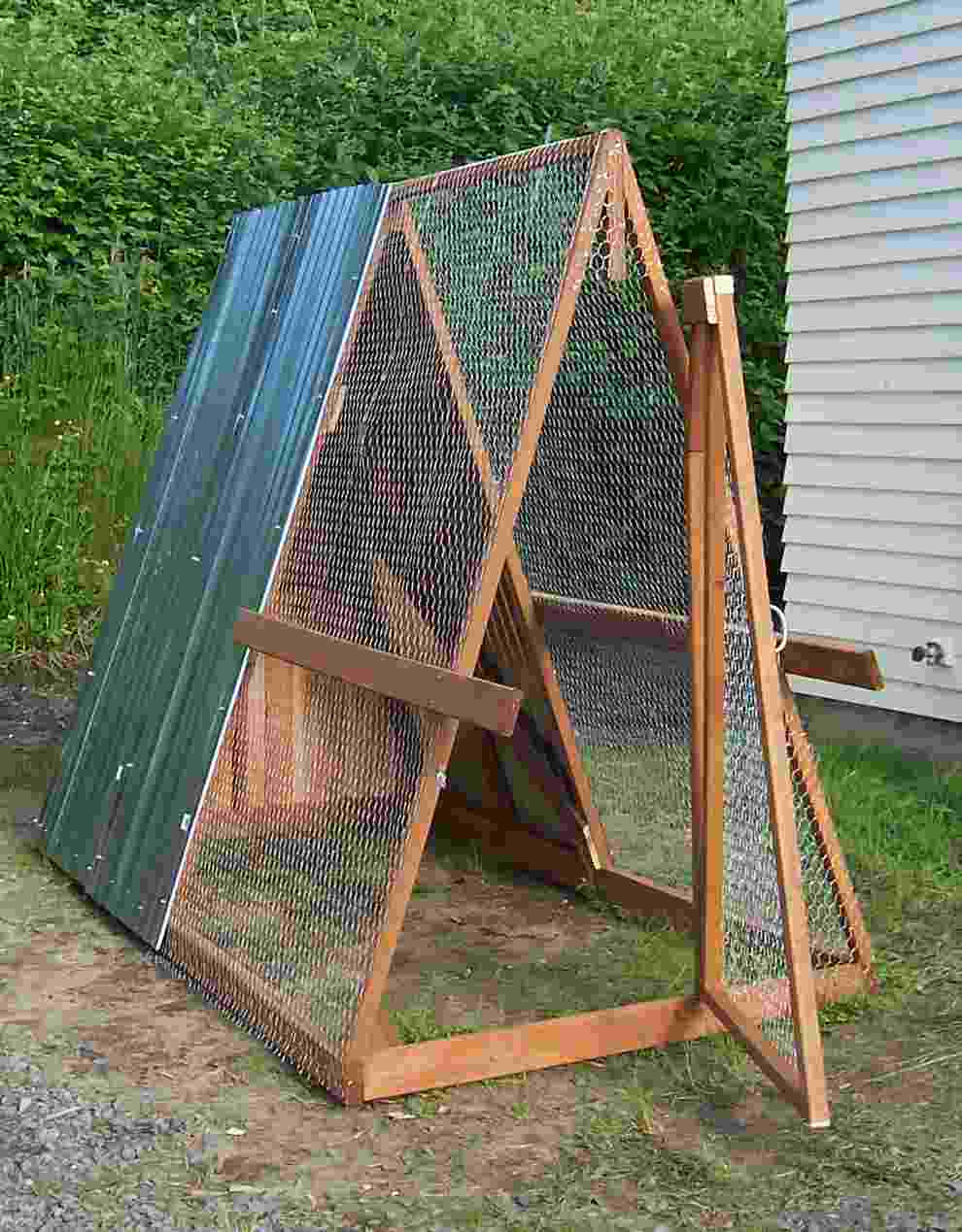 Finished product with roofing & chicken wire screen.
