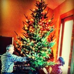 Day 24: A Sound You Heard. My dad & Christie discussig Christmas tree lights strategy.
