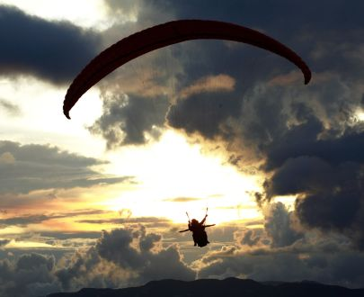 an adventure to touch the clouds while paragliding