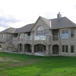 brown limestone ledgerock house finished back