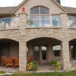 brown limestone ledgerock house weathered pillars