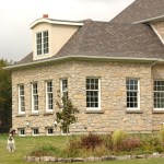 harvest gold limestone tumbled squared & ledgerock house side