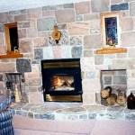 split fieldstone fireplace indoor
